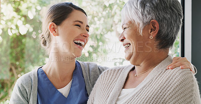 Buy stock photo Shot of a senior woman chatting with a nurse in a retirement home
