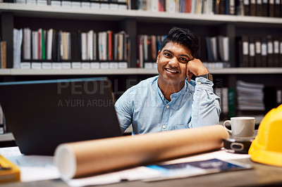 Buy stock photo Portrait of a young architect working at his desk in a modern office