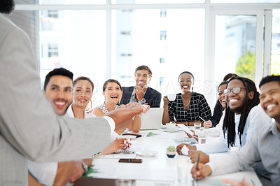 Buy stock photo Shot of a group of businesspeople listening to a presentation in a boardroom