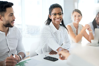 Buy stock photo Shot of a young businesswoman shaking hands with a colleague during a meeting in a boardroom