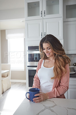 Buy stock photo Shot of a beautiful young woman having coffee in the kitchen at home