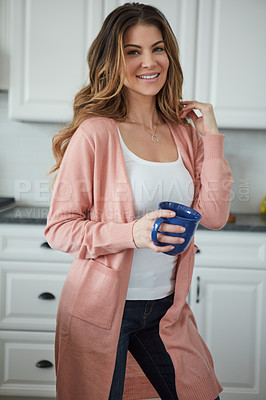 Buy stock photo Portrait of a beautiful young woman having coffee in the kitchen at home