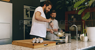Buy stock photo Shot of a mature couple preparing breakfast together at home