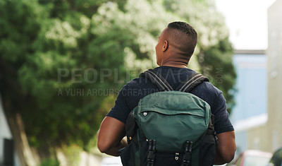 Buy stock photo Rearview shot of a young man exploring a city