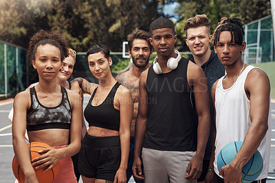 Buy stock photo Portrait of a group of sporty young people standing together on a sports court