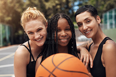 Buy stock photo Portrait of a group of sporty young women standing together on a sports court