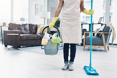 Buy stock photo Shot of an unrecognisable woman mopping the floor at home