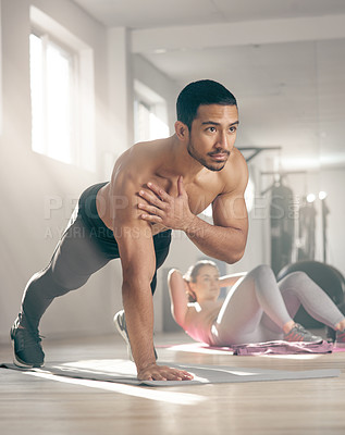 Buy stock photo Shot of a young male athlete working out at the gym