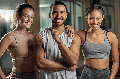 Buy stock photo Cropped portrait of three young athletes standing together in the gym