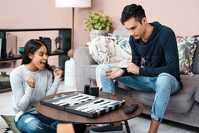 Buy stock photo Shot of a young couple playing a game of chess at home