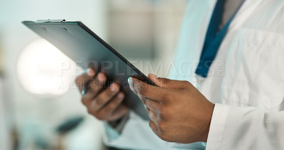 Buy stock photo Closeup shot of an unrecognisable scientist holding a clipboard in a lab