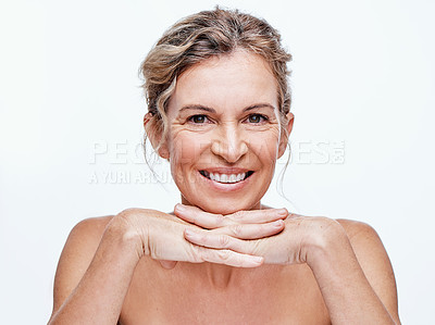 Buy stock photo Shot of a beautiful mature woman posing against a white background