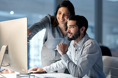 Buy stock photo Shot of a young woman helping her colleague in a call centre late at night