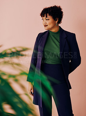 Buy stock photo Cropped shot of a stylish young woman posing against a coloured background