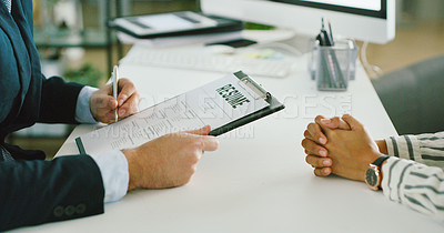 Buy stock photo Shot of a businessman reading through a resume while doing an interview