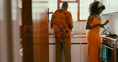 Buy stock photo Shot of a young couple preparing a meal together at home