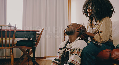 Buy stock photo Shot of a young couple spending quality time in the living room at home