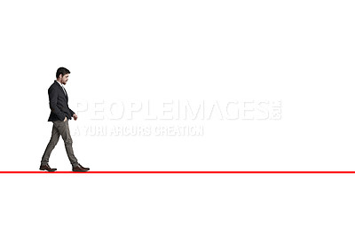 Buy stock photo Shot of a businessman walking along a straight line against a white background