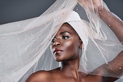 Buy stock photo Shot of a beautiful young woman wearing a head wrap