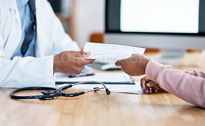 Buy stock photo Closeup shot of an unrecognisable doctor giving paperwork to a patient during a consultation