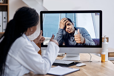 Buy stock photo Shot of a young man showing thumbs up during a video call with a doctor on a computer