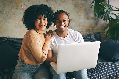 Buy stock photo Portrait of a young couple using a laptop together at home