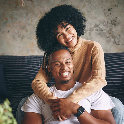 Buy stock photo Portrait of a young couple relaxing together at home