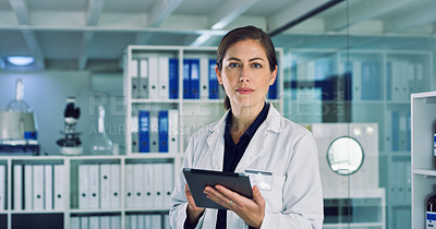 Buy stock photo Portrait of a young woman using a digital tablet in a lab
