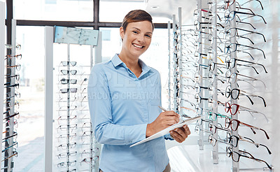 Buy stock photo Portrait of a confident young woman working in an optometrist's office