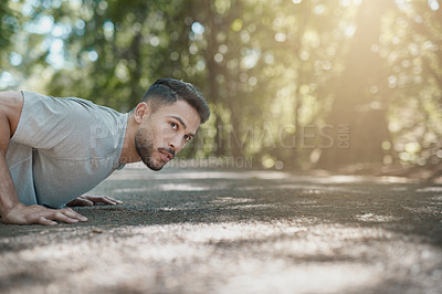 Buy stock photo Shot of a handsome young man assessing the running terrain