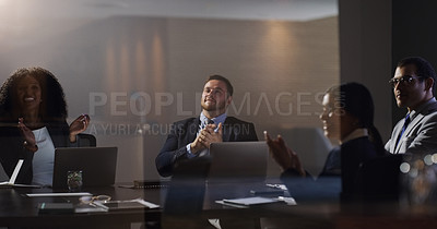 Buy stock photo Shot of a group of businesspeople clapping during a meeting in a boardroom