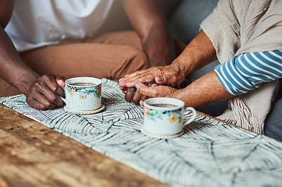 Buy stock photo Shot of two unrecognizable people sharing a cup of coffee