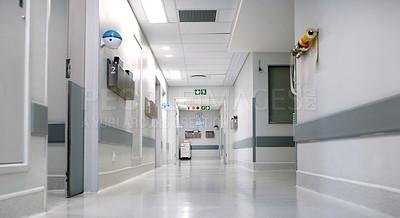 Buy stock photo Shot of an empty hospital hallway