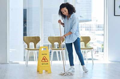 Buy stock photo Shot of a young woman mopping her floor at home