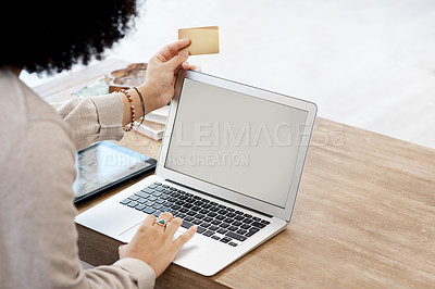 Buy stock photo Cropped shot of a woman shopping online at home