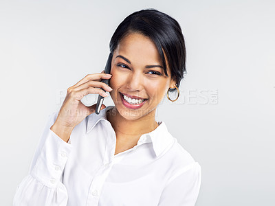 Buy stock photo Studio shot of a confident young businesswoman using a smartphone against a grey background