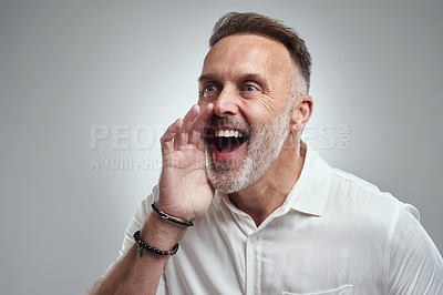 Buy stock photo Studio shot of a mature man shouting against a grey background