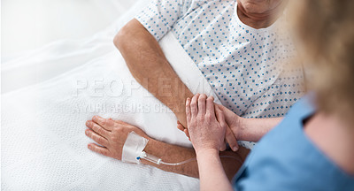 Buy stock photo Shot of an anonymous nurse checking up on one of their ailing older patients in hospital