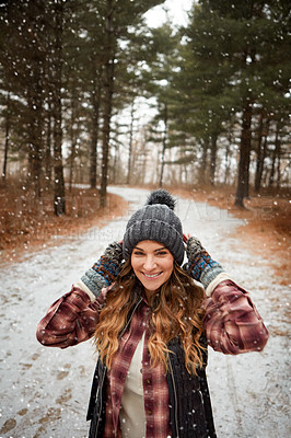 Buy stock photo Portrait of a young woman hiking in the wilderness during winter