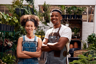 Buy stock photo Portrait of a confident young man and woman working in a garden centre