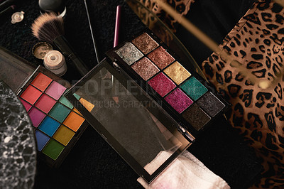Buy stock photo Shot of a makeup palette and other tools on a table backstage