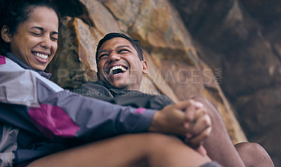 Buy stock photo Cropped shot of an affectionate young couple laughing while taking a break during their early morning hike