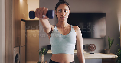 Buy stock photo Shot of a young woman working out using weights at home