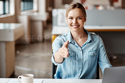 Buy stock photo Shot of a young businesswoman reaching out for a handshake in a modern office