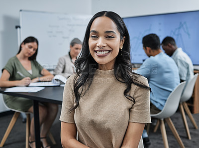 Buy stock photo Shot of a businesswoman during a staff meeting with her team