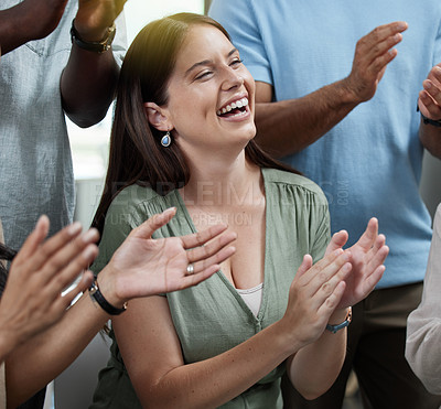 Buy stock photo Shot of a young businesswoman applauding with her colleagues in an office