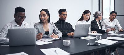 Buy stock photo Shot of a group of businesspeople working together in the boardroom