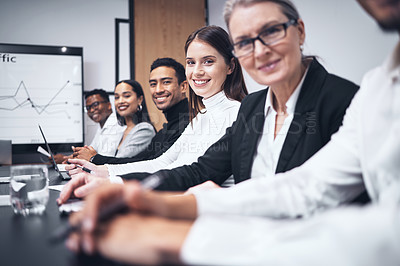 Buy stock photo Shot of a group of business people sitting together in their office
