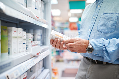Buy stock photo Cropped shot of an unrecognizable senior man shopping for medication in a pharmacy