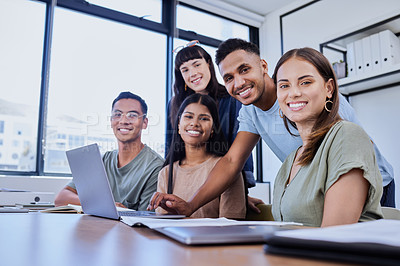 Buy stock photo Shot of a group of young people posing in an office